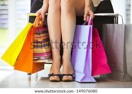 Woman\'S Legs And Shopping Bags