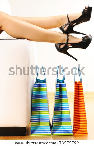 Woman's legs and shopping bags #73575799