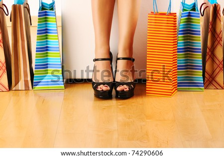Woman's legs and shopping bags