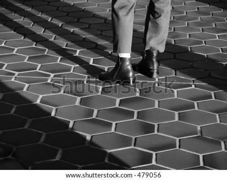 woman's legs/feet, standing on tile