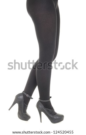 Woman's legs in black tights over white