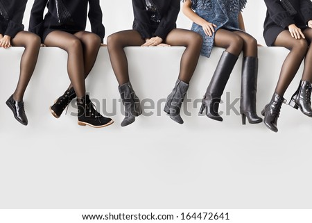 Woman\'S Legs In Different Shoes