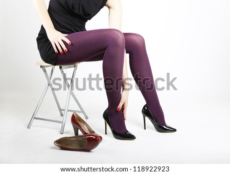 Woman's Legs Trying on Shoes with a White Studio Background