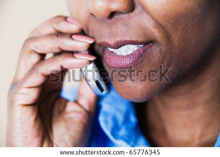 Woman's mouth talking on cell phone