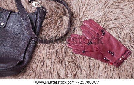 Woman's red leather gloves