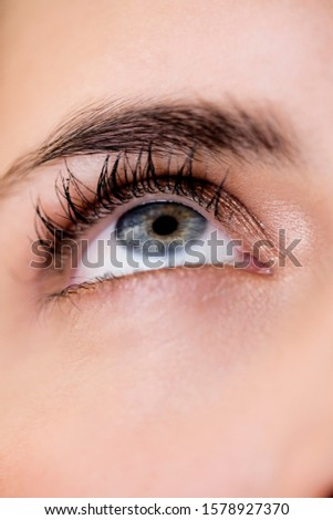 Woman's right eye and eyebrow, looking upwards