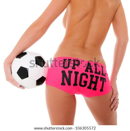 Woman\'s Sexy Backside Holding a Soccer Ball