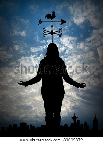 Woman`s silhouette with weather vane