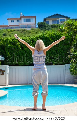 woman's standing near the swimming pool in a hotel