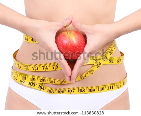 woman's waist with measuring tape holding red apple, isolated on white