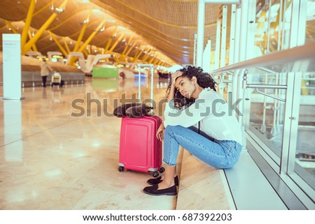 Woman sad and unhappy at the airport with flight canceled