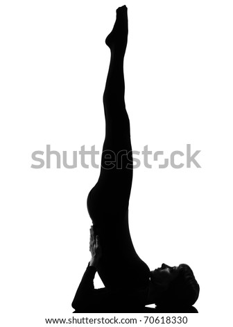 woman salamba sarvangasana Shoulder Stand yoga pose  posture position in silouhette on studio white background full length
