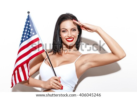 Woman salute with little USA flag, july 4th