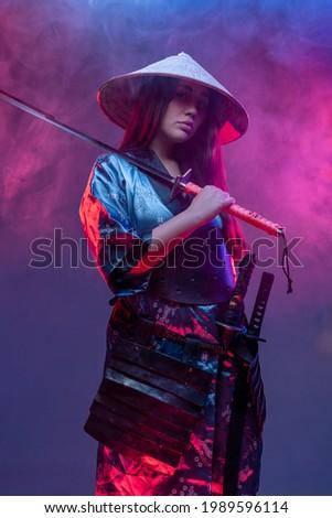 Woman samurai in cyberpunk style with katana