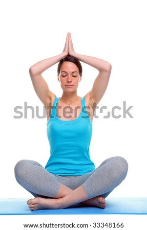 Woman sat in a yoga position meditating, isolated on a white background.