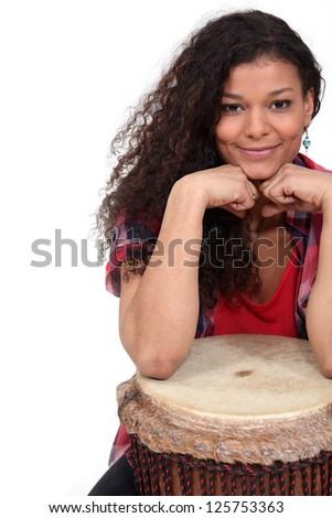Woman sat with bongo Stock fotó ©