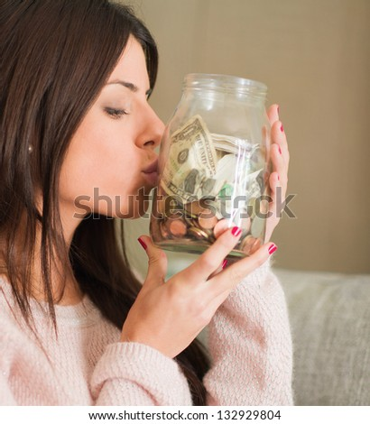 Woman Saves Money And Coins For The Future, Indoors