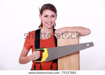 Woman sawing a wooden floor board - stock photo