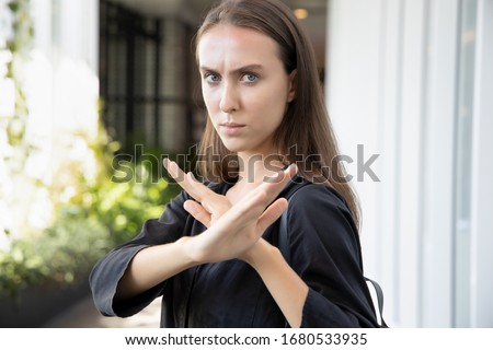 woman saying no or stop with hand gesture; caucasian white woman puts her hand up for stop, halt, no way, rejection, turning down, disapproval, broken deal; Russian caucasian young adult woman model Foto stock ©