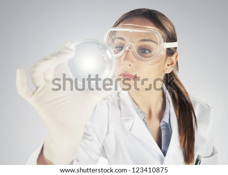 Woman scientist analyzing Petri dishes in the laboratory- Portrait of a young chemist working with medicine