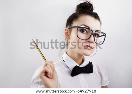 Woman scientist, professor or student with dorky glasses and pencil, pointing to copy space - stock photo