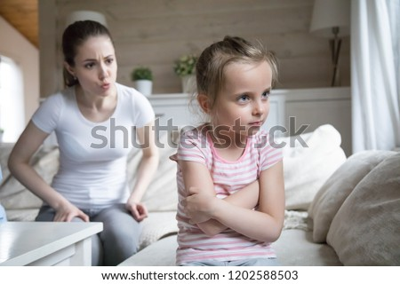 Woman scolding little girl. Millennial mother screaming shouting to small preschool daughter. Complicated relations between mom and kid, misunderstanding conflict in family or child punishment concept #1202588503