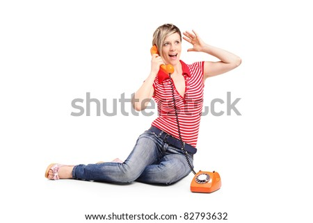 Woman screaming into the old style phone isolated on white background