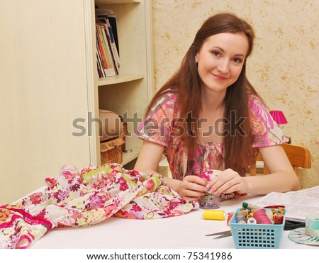 Woman seamstress work