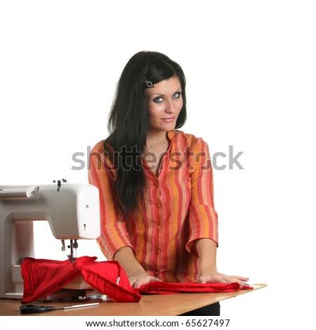 Woman seamstress work on the sewing-machine