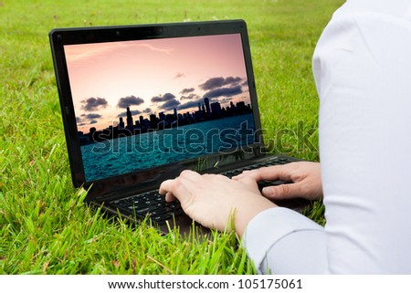 Woman searching holiday city destination outdoors on laptop