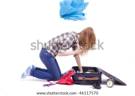 woman searching something into the travel bag