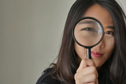 woman searching, viewing, finding with magnifying glass, girl searching concept