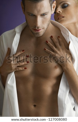 Woman seducing man isolated over purple background