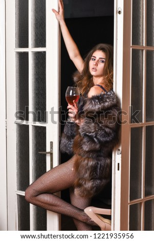 Woman seductive model wear luxury fur and elite lingerie. Confident in her magnetism. Seduction art concept. Girl you dream about. Fashion lady enjoy her seductiveness. Woman seductive appearance.