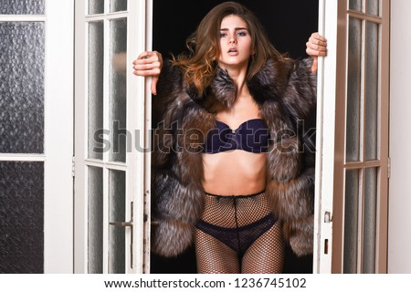 Woman seductive wear luxury fur and lingerie. Seduction art concept. Female lover enter bedroom doors. Fashion lady confident and seductive. Woman seductive appearance. Confident in her magnetism.