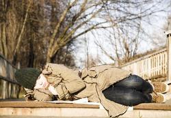 Woman Seeping On The Street. Economic Crisis Series