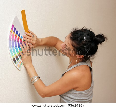 woman select a color to paint her wall