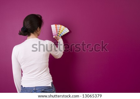 woman select a color to paint her wall (with copy space)