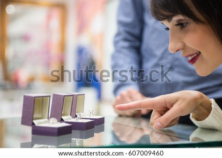 Woman selecting a finger ring in jewelry shop