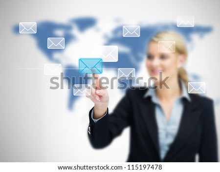 Woman selecting email symbol on world map background
