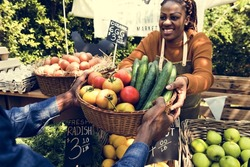 Woman Selling Fresh Local Vegetable at Farmers Market