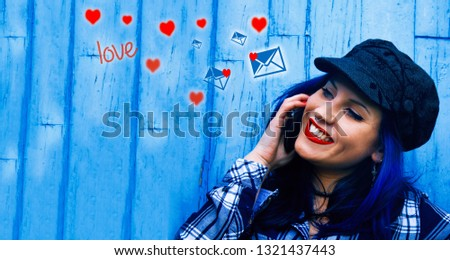 woman sending messages of love with the mobile phone #1321437443