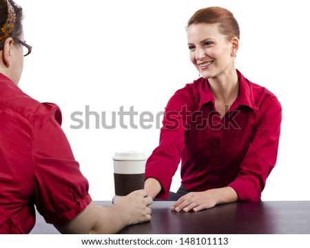 woman serving coffee behind the counter #148101113