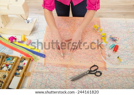 Woman sewing at home with sewing paper #244161820
