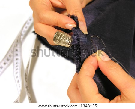 Woman sewing with thimble, needle and thread