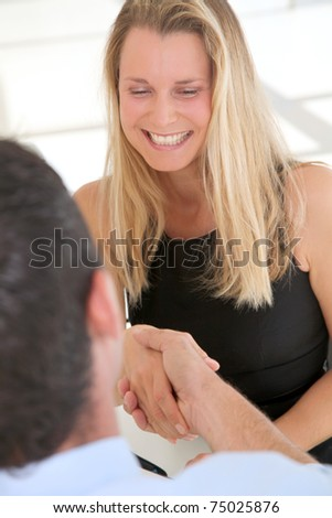 Woman shaking hand for business collaboration