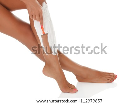 Woman shaving her legs, white background