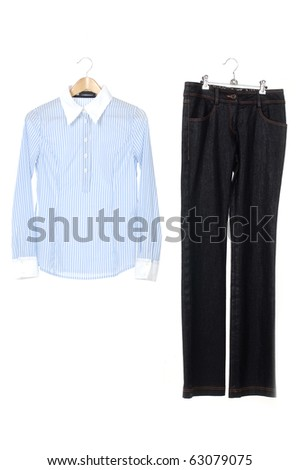 Woman shirt and trousers on a hanger studio isolated