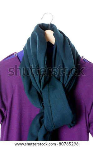 Woman shirt with blue scarf on a wooden hanger