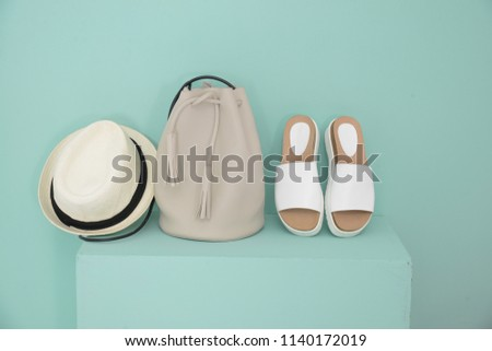 woman shoes with hat, handbag on cube isolated- green background  #1140172019